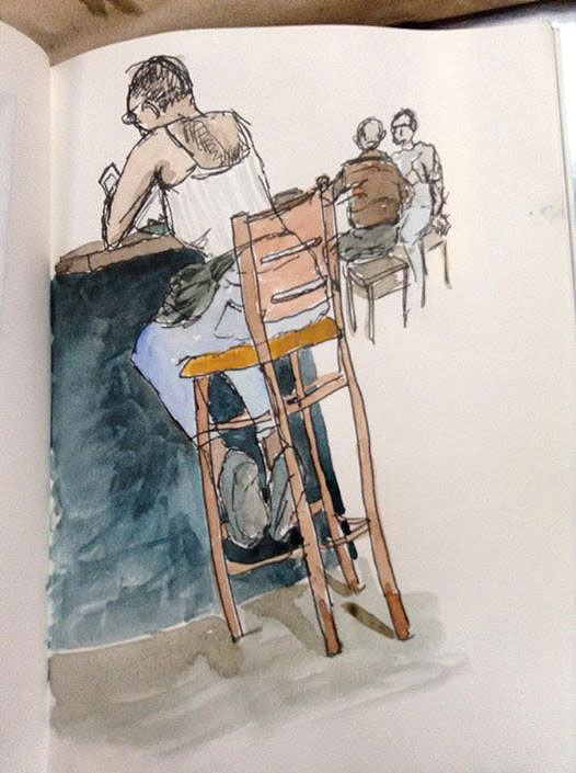 a pen and watercolor sketch of a woman eating at a counter in a cafe